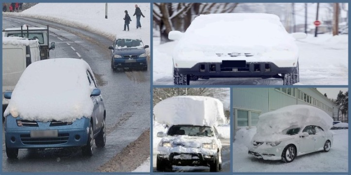 Driverless cars covered in snow
